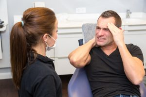 neck pain after tooth extraction dentist consultation