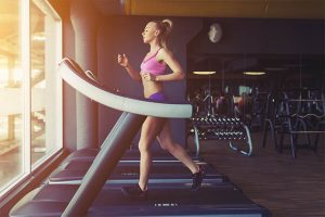 The woman exercises daily on the treadmill.